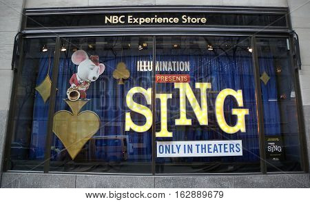 NEW YORK - DECEMBER 15, 2016: NBC Experience Store window display decorated with Sing film promotion by Illumination Entertainment in Rockefeller Center in Midtown Manhattan