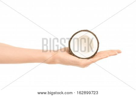 Healthy Eating And Diet Topic: Human Hand Holding A Half Of Coconut Isolated On A White Background I