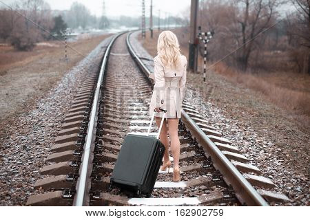 Girl For A Train Rails In Winter.