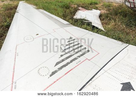 Plane Wing Wreckage Sitting On The Ground