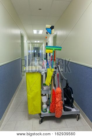 Bucket with cleaning items in a corridor. Stock photo