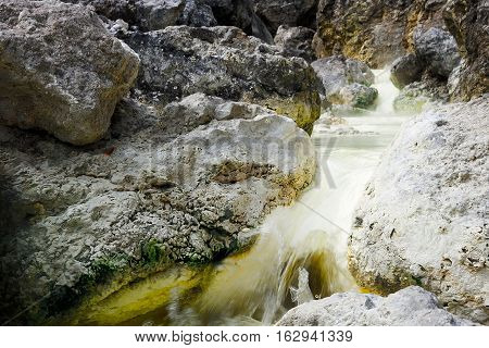 Natural Hot River rich with sulfur, Hot Springs with yellow water