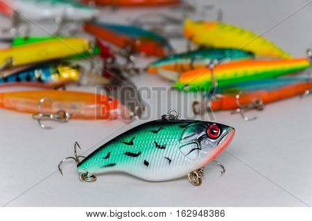 colored wobblers for fishing on a light background
