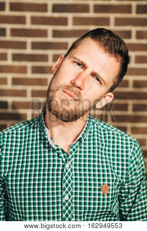 dissatisfied man, Portrait of a funny hipster man looking at camera
