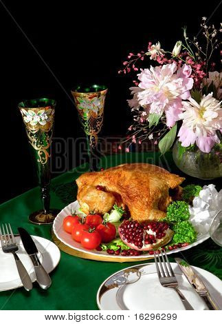Still-life with the chicken, flowers and glasses