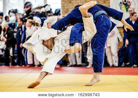 fight two judoka athlete on tatami judo competitions