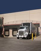 stock photo of loading dock  - Freight Truck at loading bay with copy space - JPG