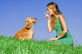 stock photo of cute dog  - young woman with dog - JPG