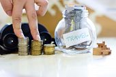 Travel Budget - Vacation Money Savings In A Glass Jar On World Map. poster