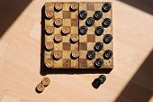 stock photo of draught-board  - An old draughts  - JPG