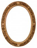 stock photo of oval  - Oval gold picture frame with a decorative pattern - JPG