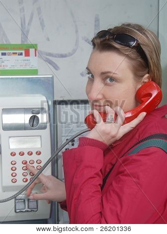 Girl using public phone