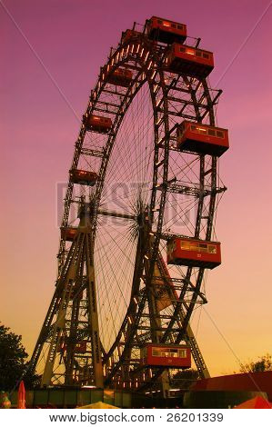 Old ferris wheel in amusement park Prater in Vienna at dusk