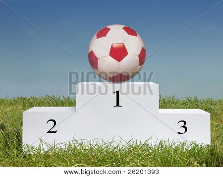 Soccer ball on first place podium