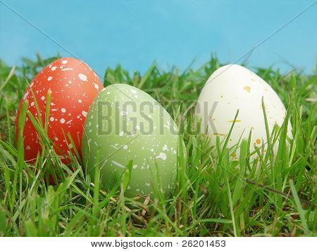Three speckled eggs in grass