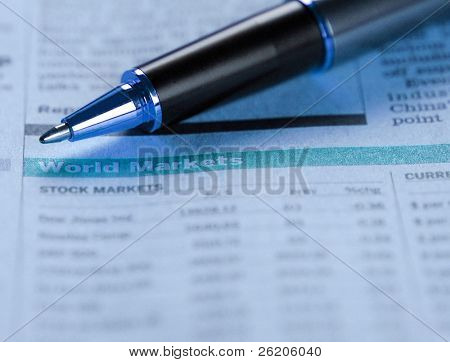 Pen pointing on world markets report