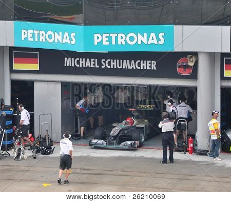 SEPANG, MALAYSIA - APRIL 3: Pit crews prepare Michael Schumacher's car at  Qualifying Session of Malaysian F1 Grand Prix April 3, 2010 at Sepang International Circuit in Malaysia.