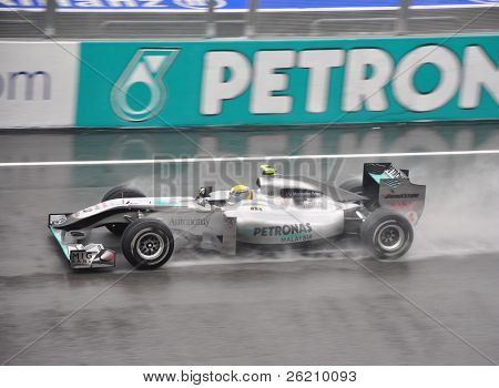 SEPANG F1 CIRCUIT, MALAYSIA - APR 3 : Nico Rosberg of Team Mercedes GP  speeding on wet track during qualifying session on April 3, 2010 in Sepang F1 Circuit, Malaysia