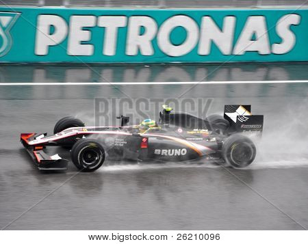 SEPANG F1 CIRCUIT, MALAYSIA - APR 3 : Hispania Racing F1 driver Bruno Senna speeding on wet track during qualifying session on April 3, 2010 in Sepang F1 Circuit, Malaysia