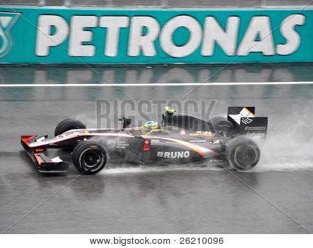 SEPANG F1 CIRCUIT, MALAYSIA - APR 3 : Hispania Racing F1 driver Bruno Senna speeding on wet track during qualifying session on April 3, 2010 in Sepang F1 Circuit, Malaysia