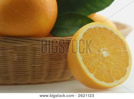 Fresh Oranges In Basket