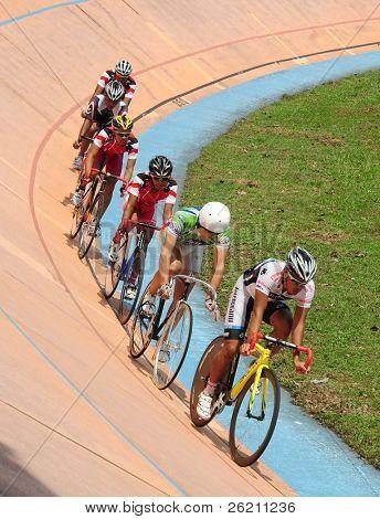KUALA LUMPUR - NOVEMBER 13: Unidentified cyclists participate in the Kuala Lumpur International Fixed Gear Tournament 2011 at the Kuala Lumpur Velodrome on November 13, in Kuala Lumpur, Malaysia