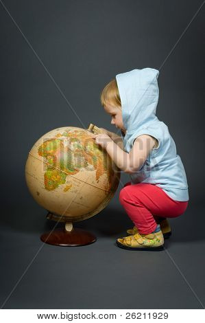 Cute Little Baby With Globe Isolated On Grey