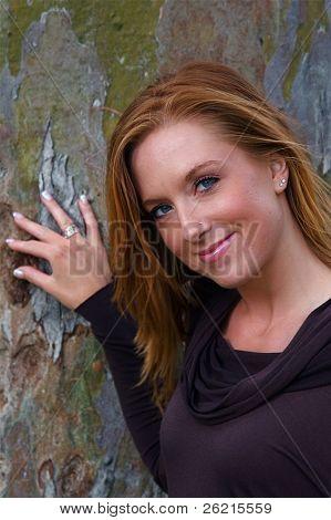 Young beautiful woman in an autumn setting
