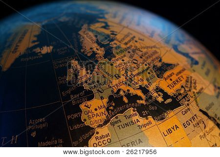 Close up view of a world globe against black