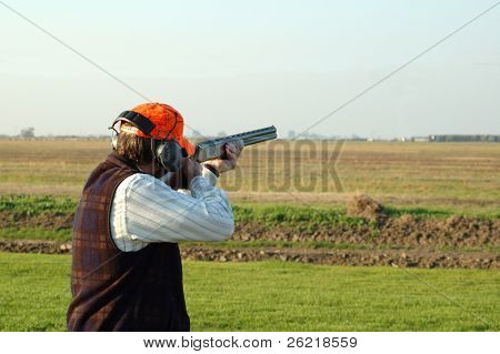 A left-handed shotgun shooter on the trap range closeup