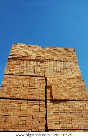 Lumber stacked in a building suppliers yard