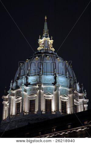 San Francisco Civic Center illuminated at night.with a reflection after a rain