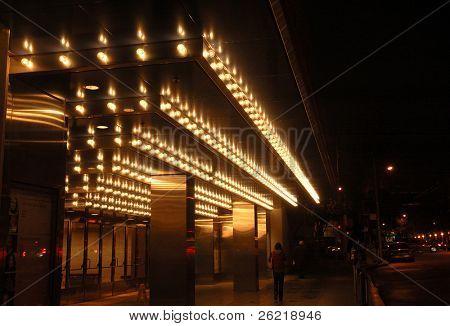 San Francisco opera house entrance illuminated at night.with a reflection after a rain