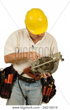 Carpenter checking teeth on circular saw