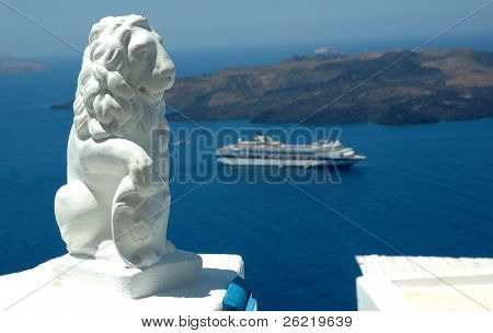Statue and cruise ship in the caldera at Santorini a Greek island in the mediterranean