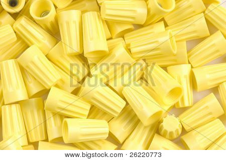 Yellow wirenuts used for connecting 12 gauge wire in household circuits as a for use as a background