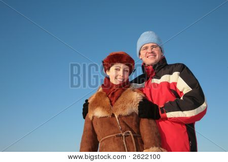 Couple Against Blue Sky Background In Winter 2