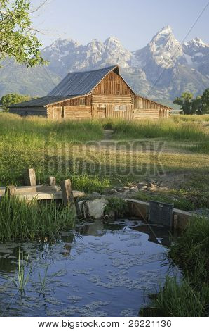 iconic scene of old Moulton Mormon wooden barn (circa 1880's) on Mormon Row in the Teton National park