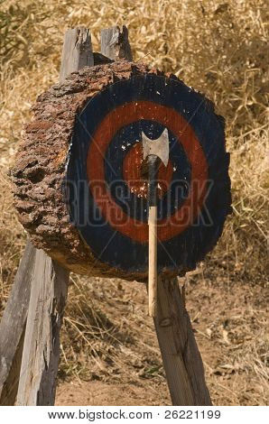 Axe in the target at a lumberjack axe throwing competition