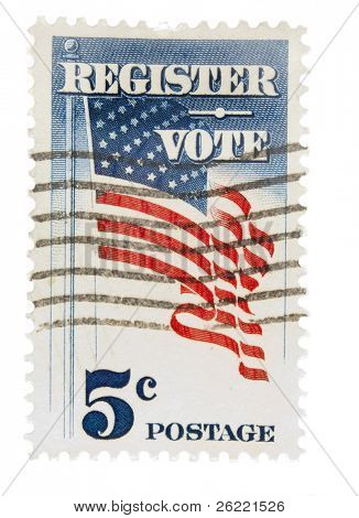 "UNITED STATES - CIRCA 1960: A 5 cent Vintage US postage stamp depicting US flag on a pole waving with inscription ""Register Vote"", circa 1960"