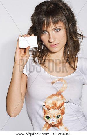 Beautiful smiling woman holding a membership card