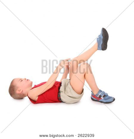 Boy Lie Isolated On White. Pain Leg