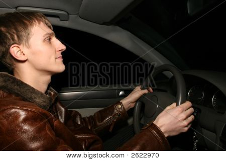 Man In Car At Night
