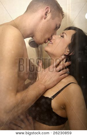 intimate young couple during foreplay in shower