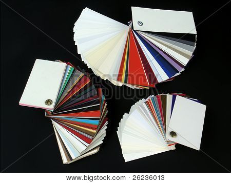 Colored samples of different papers on black background