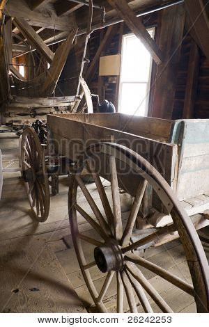 Antique horse-drawn wagon stored in a barn