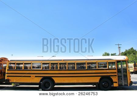 Side view of a school bus in the lot