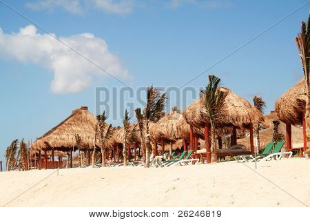 Thatched huts for shade along the beach