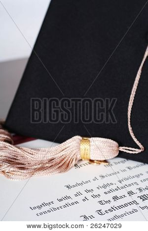 "Graduation diploma with a tassel and mortarboard in the background...focus is on ""Bachelor of Science"""