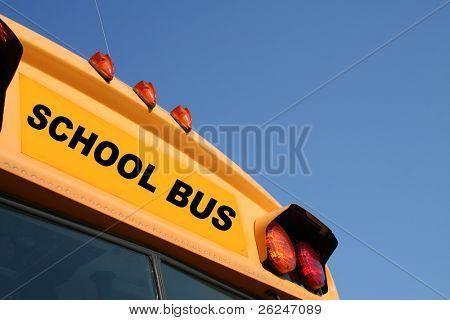 Yellow school bus against a blue sky